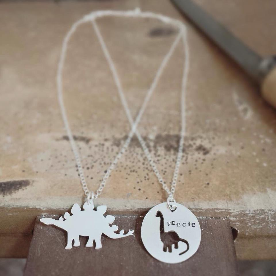 two silver necklaces with pendants