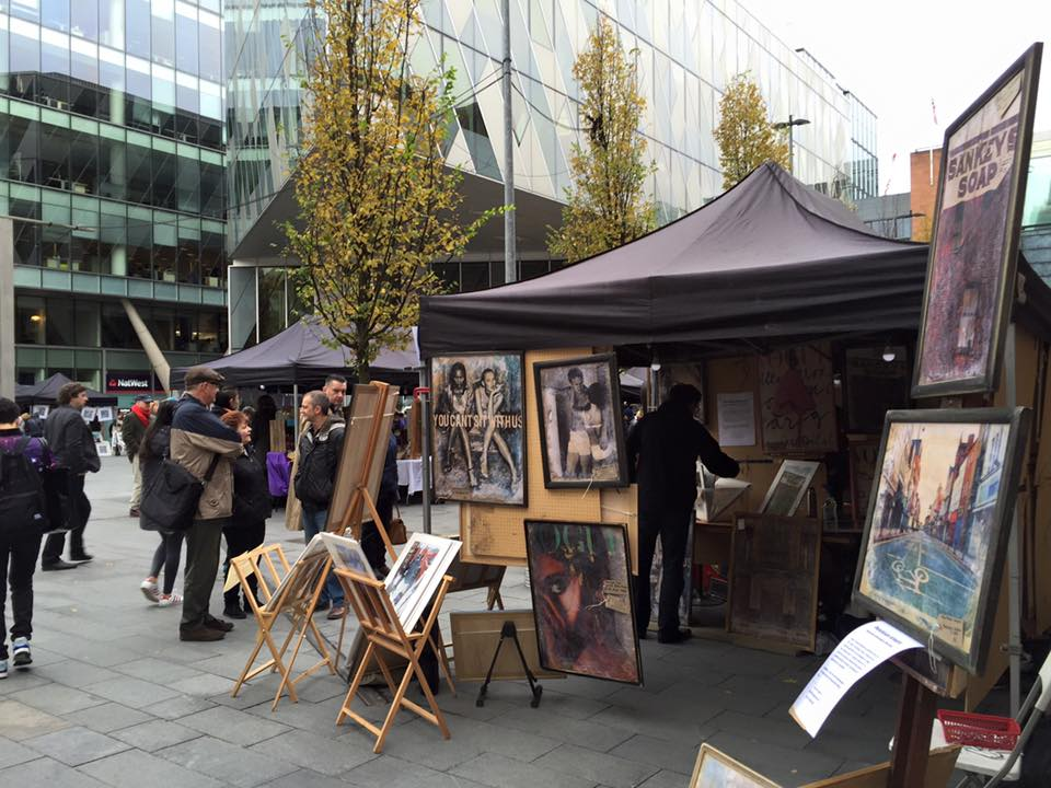 A stall selling paintings and photographs