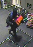CCTV footage of armed robber at local supermarket