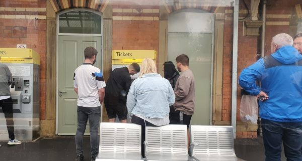 Passengers getting tram tickets picture by Rebecca Redican