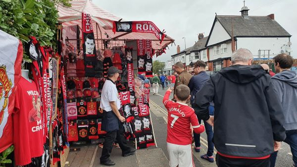 Manchester United fans treat themselves to merchandise. Pictures by Rebecca Redican