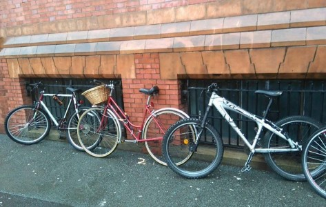 Bikes chained up against wall