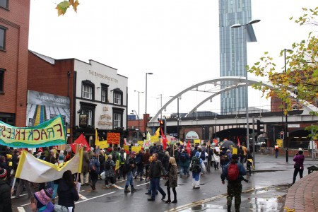 thousands marching outside Manchester icon, the Beetham Tower