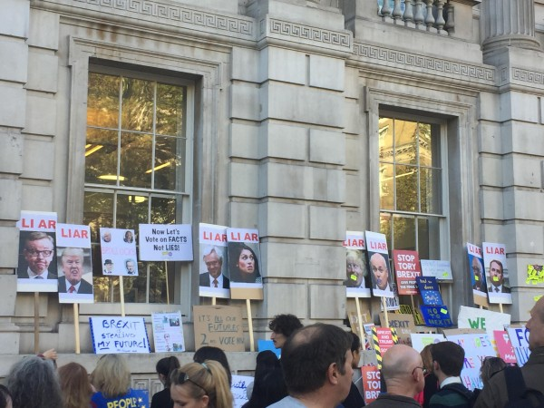 Protesters left placards outside parliament describing Brexiteers as Liars