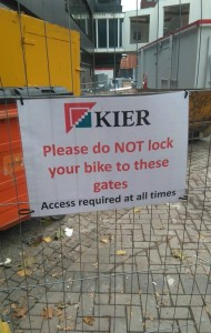 Sign asking students not to lock their bike to the fences