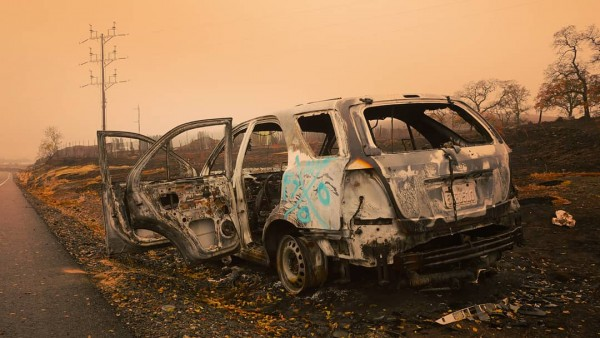 Damage caused by Campfire. A burnt car