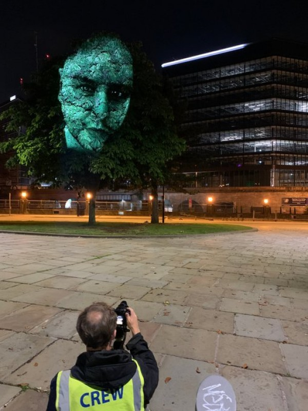 City of Trees charity projected images of key workers onto trees in Manchester city centre