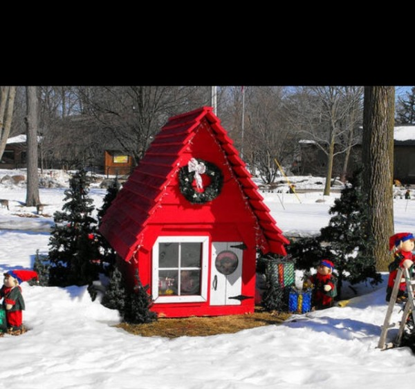 Elf on The Shelf's magical home: a red chalet with a wreath set in a snowy landscape