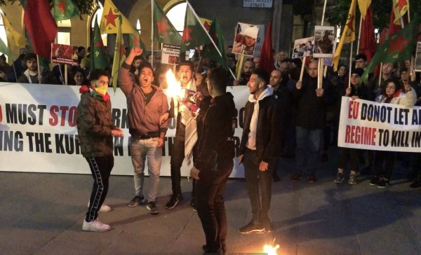 Protesters setting fire to picture of Erdoğan