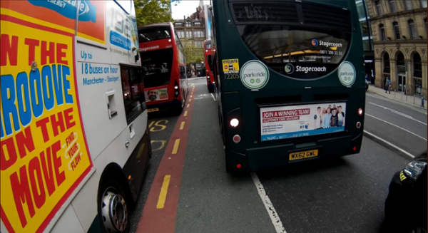 Greater Manchester cycle lane and buses in city centre