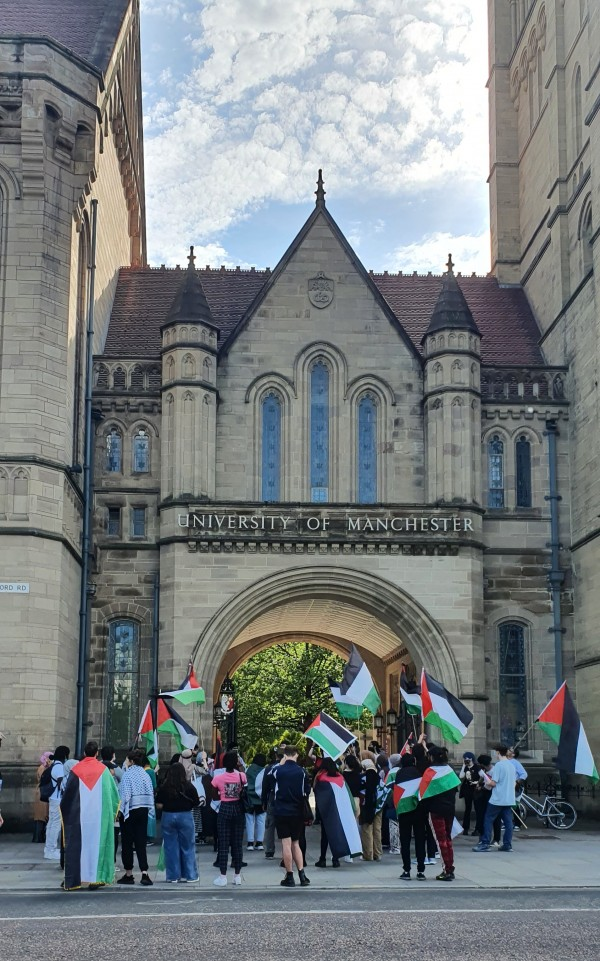 Protesters stand outside UOM's Whitworth building to protest its association with Israel