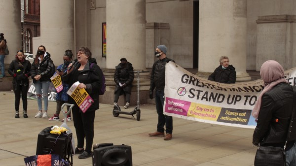 woman, protest, shout, sign, manchester