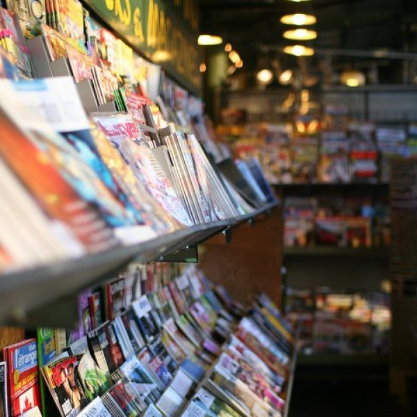 Image of a magazine stand inside of a shop.