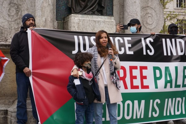 Beesan Arafat and her son speak to the crowd. Photo By Victoria Thiele