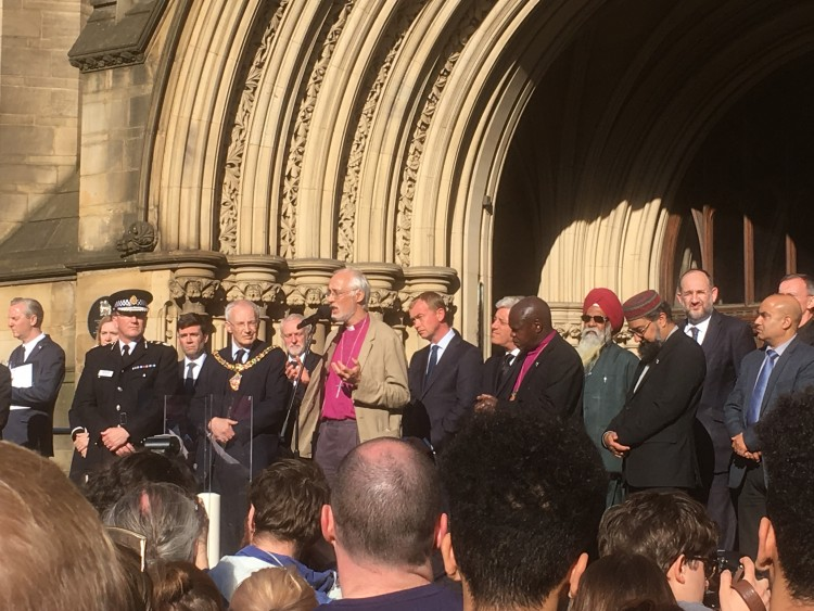 Speakers on the stage at the Albert Square vigil