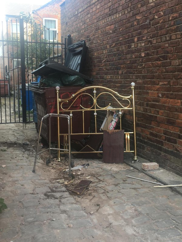 Bedframe and other items found next to a bin