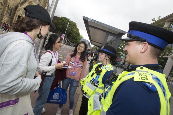 Community support officers speak to students
