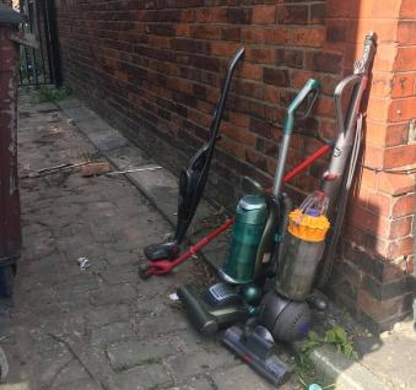 Vacuum cleaners left in alley