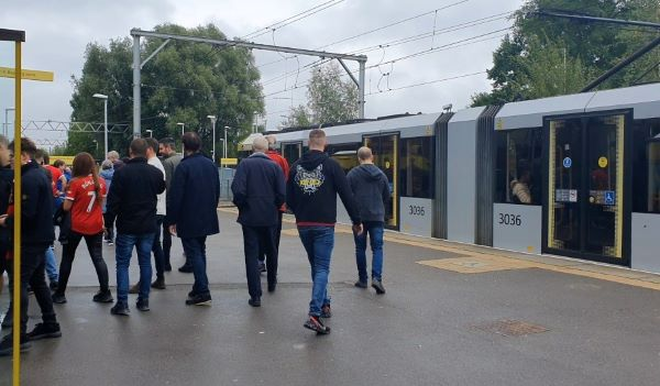 Manchester visitors leaving the tram as 80% of trams are cancelled pictures by Rebecca Redican