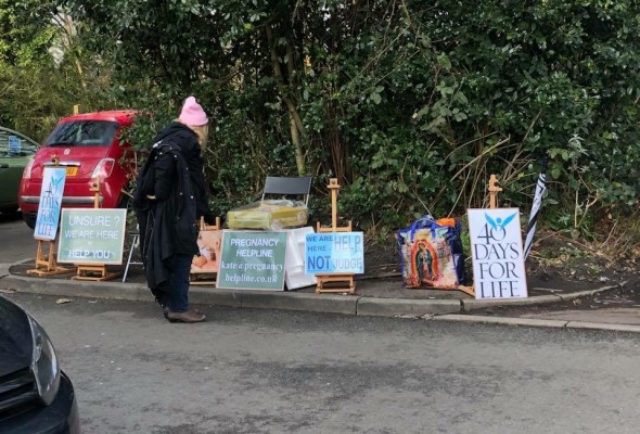 Protest posters outside Fallowfield Marie Stopes clinic Manchester