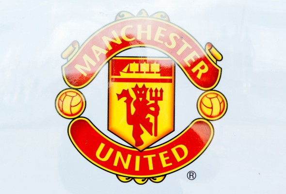 Manchester United badge; Credit: Toby Burton