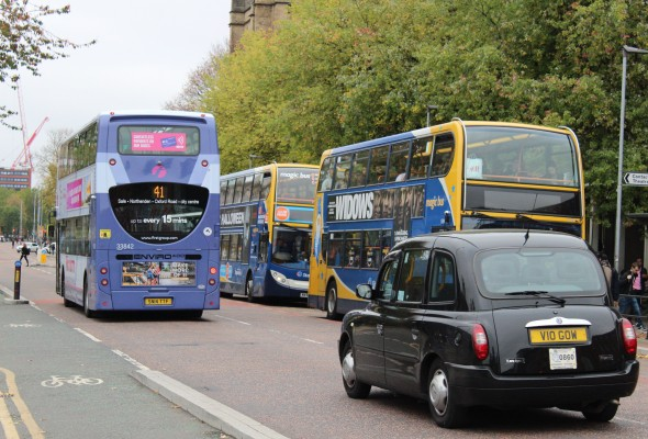 Busy Traffic with Buses and Taxis on Oxford Road in Manchester