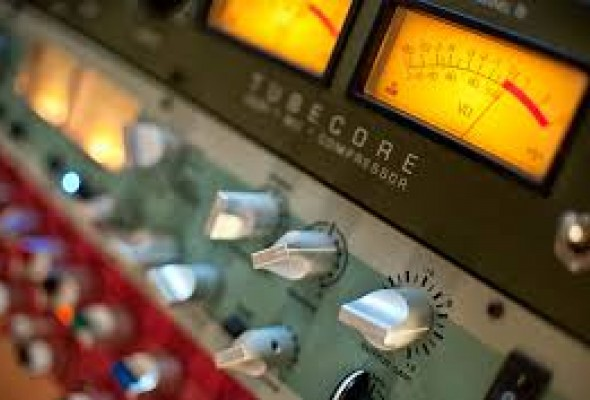 Audio meters and dials on a studio console