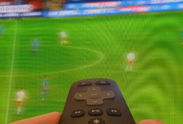 Image of a television screening football