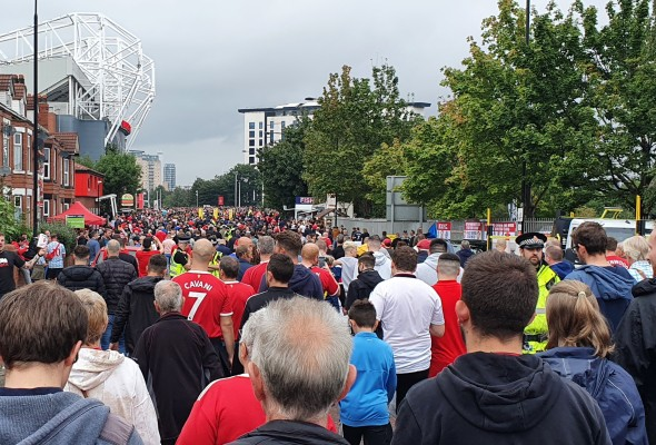 Thousands of football fans leaving Old Trafford tram after strikes suspended