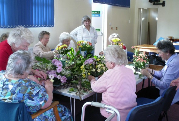 Picture of elderly people flower arranging