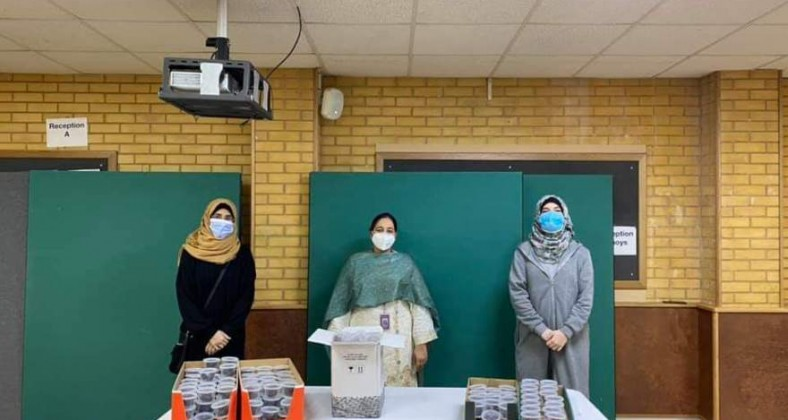 Volunteers at Khizra Mosque with dates for NHS workers