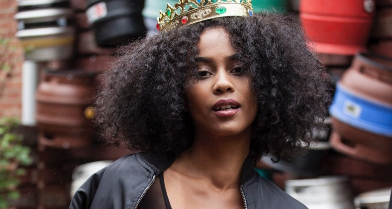 An image of IAMDDB in a gold crown