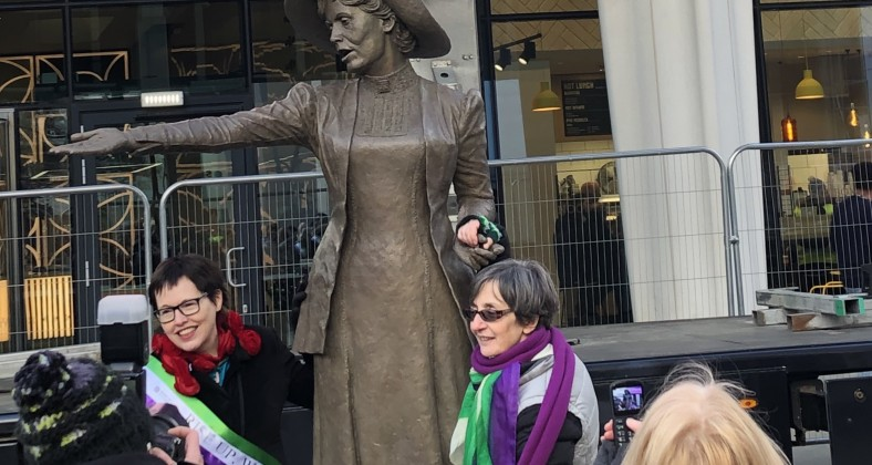 Hazel Reeves, sculptor of the Emmeline Pankhurst statue and Helen Pankhurst, her great granddaughter stand either side of the statue.