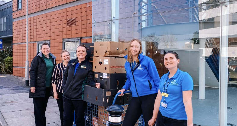 Maddie Leivers and colleagues receiving donation from Morrisons supermarket at Blackpool Hospital