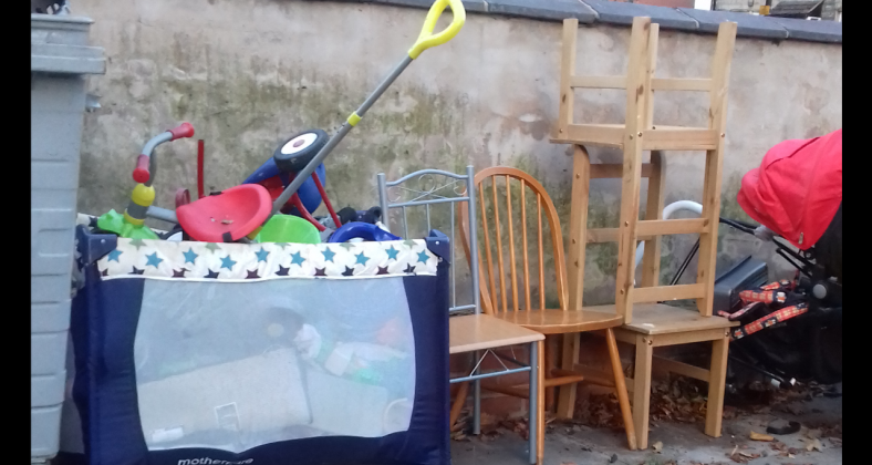 Toys and furniture left outside bins.