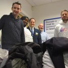 John Leech donates clothing with Human Appeal Campaigners