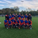 MMU Men's Football 1st Team smile for the camera before their 4-0 drubbing of UoM