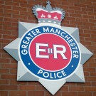 insignia of greater manchester police