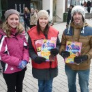 Image of two women and a man holding copies of The Big Issue magazine.