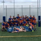 MMU's men's rugby league team smile for the camera after their 52-28 victory over Salford