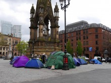 Homeless people in tents in Albert Square in Manchester