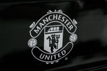 Manchester United badge on black