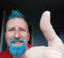 Horwich postman, Andrew Davies, in his new blue Mohican