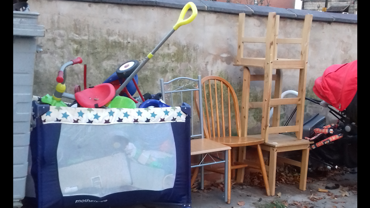 Toys and furniture left outside bins